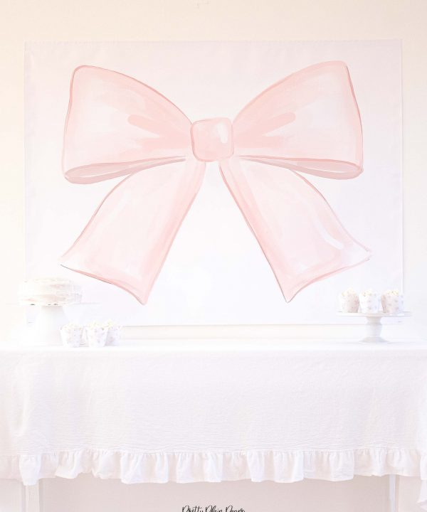 Watercolor pink bow backdrop for a pink bow birthday party by Pretty Plain Paper